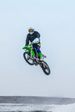High jump athlete on a motorcycle Royalty Free Stock Photos