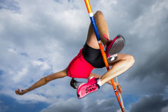 High jump. Female athlete in high jump in track and field Royalty Free Stock Photo