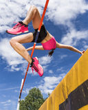High jump. Female athlete in high jump in track and field Royalty Free Stock Images