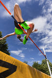 High jump. Female athlete in high jump in track and field Stock Photos