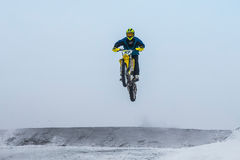 High jump and flight athlete motorcycle on a winter road Stock Images