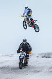 High jump and flight athlete motorcycle on a winter road Royalty Free Stock Photos