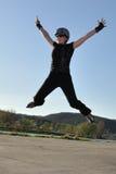 High jump on inline skates stock photo