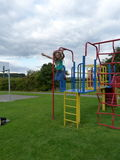 The high jump. A leap from the climbing frame Royalty Free Stock Photo