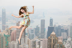 High jump over cityscape Stock Images