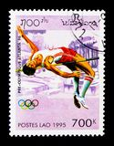 High jump, Pre-Olympics, Atlanta 1996 serie, circa 1995. MOSCOW, RUSSIA - NOVEMBER 25, 2017: A stamp printed in Lao People's Democratic Republic shows High jump Royalty Free Stock Photos