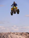 High jump on quadrocycle. Royalty Free Stock Images