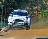 High jump by rally car stock image