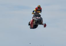 High jump of sportsman on snowmobile Stock Photo
