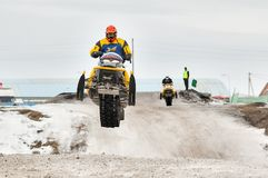 High jump of sportsman on snowmobile Stock Photography