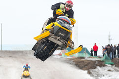 High jump of sportsman on snowmobile Royalty Free Stock Image