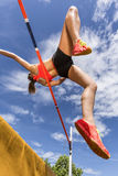 High jump in track and field. Young woman in high jump in track and field royalty free stock images