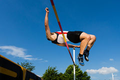 High jump in a worm eye's view Royalty Free Stock Photo