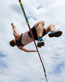 High jump in a worm eye's view Royalty Free Stock Image