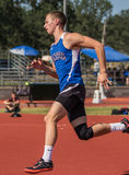 The High Jumper. A high jumper makes his approach during a track meet in Cottonwood, California Stock Photo
