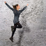 High jumphing girl Stock Images