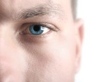 High key blue eye. High key image showing sharp blue eye with softened skin to allow for copy space stock photo