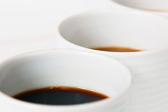 High key close-up of coffee cups Royalty Free Stock Image