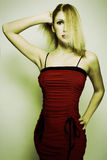 High Key Fashion. Blonde fashion model in red ress Royalty Free Stock Photo