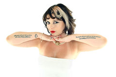 High Key Head Shot. A high key head shot of a woman with tattoos royalty free stock photography