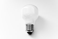 High-key light bulb, concept of clean energy. Lightbulb on white, high key image representing the quest for clean energy Stock Photography