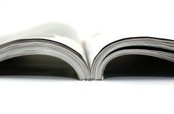 High key photo of magazine on white background. Stock Images
