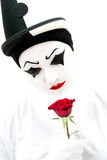 High key pierrot with rose. High key image of a white Pierrot clown with a red rose stock images