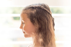 High-key portrait of girl with braided hair Stock Photo