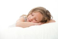 High key portrait of girl sleeping. Royalty Free Stock Images