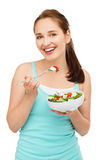 High key Portrait young caucasian woman eating salad isolated o Stock Photo
