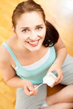 High key Portrait  young caucasian woman eating yogurt at home Stock Photo