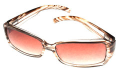 High key sun glasses. High key image of a pair of sun glasses Royalty Free Stock Image