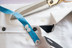 High key white shirt with measuring tape. And scissors showing fitting, design, perfect fit and tailoring Royalty Free Stock Images