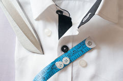 High key white shirt with measuring tape. And scissors showing fitting, design, perfect fit and tailoring Royalty Free Stock Image