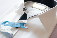 High key white shirt with measuring tape. Showing fitting, design, perfect fit and tailoring Stock Image