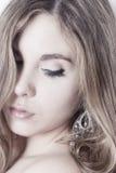 High key woman portrait. High key profile woman portrait with silver jewel royalty free stock photography