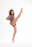 High kick dance by happy young woman in studio Stock Photo