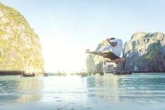 High kick. Flying high kick in maya bay, thailand Royalty Free Stock Photography