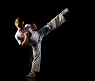 High kick pose Royalty Free Stock Photos