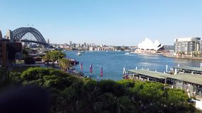 Elevated View of Circular Quay With the Sydney harbour Bridge and the Opera House, Australia. High level view from the Cahill Walkway of Circular Quay, Sydney stock footage