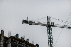 High lift crane on the construction site royalty free stock photography