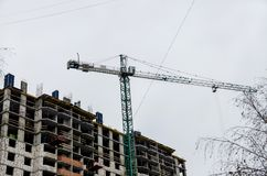 High lifting crane during construction royalty free stock photography