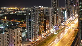 High light traffic road time lapse from dubai. Time lapse from the roof in the night in dubai city stock video footage