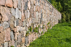 High limestone wall of large colorful boulders Stock Photography