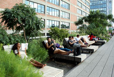 High Line.  New York City. Elevated pedestrian Park. NEW YORK CITY - SEPTEMBER 03: People at High Line Park in NYC on September 03th, 2013. The High Line is a Stock Photos