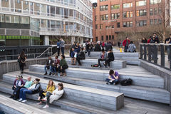 HIGH LINE PARK. NEW YORK CITY - APRIL 6, 2015:    View of the 10th Avenue Square Overlook on The High Line park with visitors relaxing and mingling Stock Photos