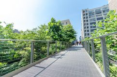 High Line Park. NEW YORK CITY - JULY 22: People walk along the High Line Park on July 22, 2014. The High Line is a popular linear park built on the elevated Royalty Free Stock Image