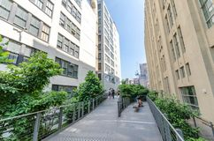High Line Park. NEW YORK CITY - JULY 22: People walk along the High Line Park on July 22, 2014. The High Line is a popular linear park built on the elevated Stock Photo