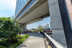 High Line Park. NEW YORK CITY - JULY 22: People walk along the High Line Park on July 22, 2014. The High Line is a popular linear park built on the elevated Stock Image