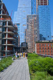 High line park in New York. NEW YORK CITY - MAY 28 : The High Line Park in NYC on May 28, 2016. The High Line is a public park built on an historic freight rail Royalty Free Stock Photo